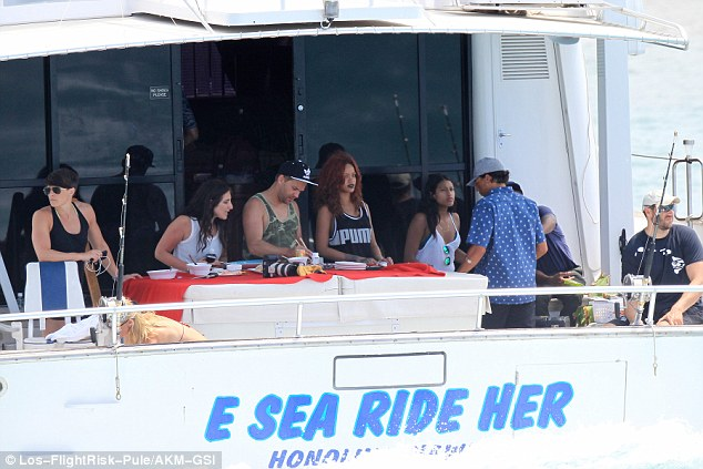 Giggles: No doubt Riri got a kick out of the boat's name
