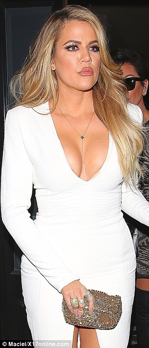 Flaunting their assets: Khloe took the selfie wearing this plunging designer gown that she wore on an evening out in Hollywood on Thursday. It turns out she borrowed it from sister Kim who wore it in April 2014