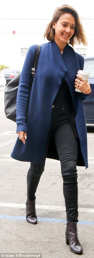 Casual chic: The actress showed off her slim figure in a flitted black blouse and high-waisted skinny jeans which she layered with a long blue cardigan