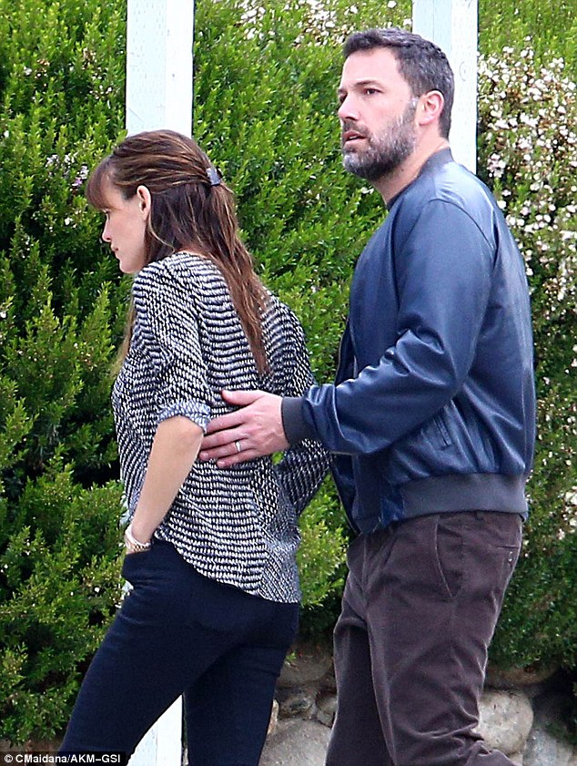 Looking out for her: Ben Affleck instinctively put his hand on wife Jennifer Garner's back as he made sure they both crossed the road safely on Friday in LA