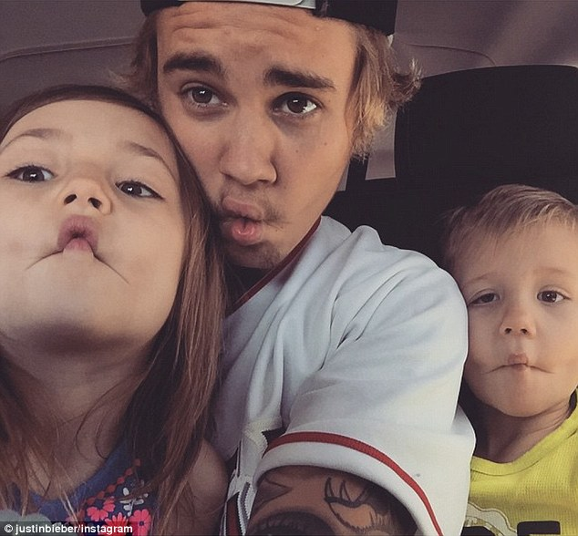 Sibling love: Earlier this month, the pop star Instagrammed a photo with his half-siblings Jazmyn, 6, and Jaxon, 4, with whom he shares a father, Jeremy Bieber