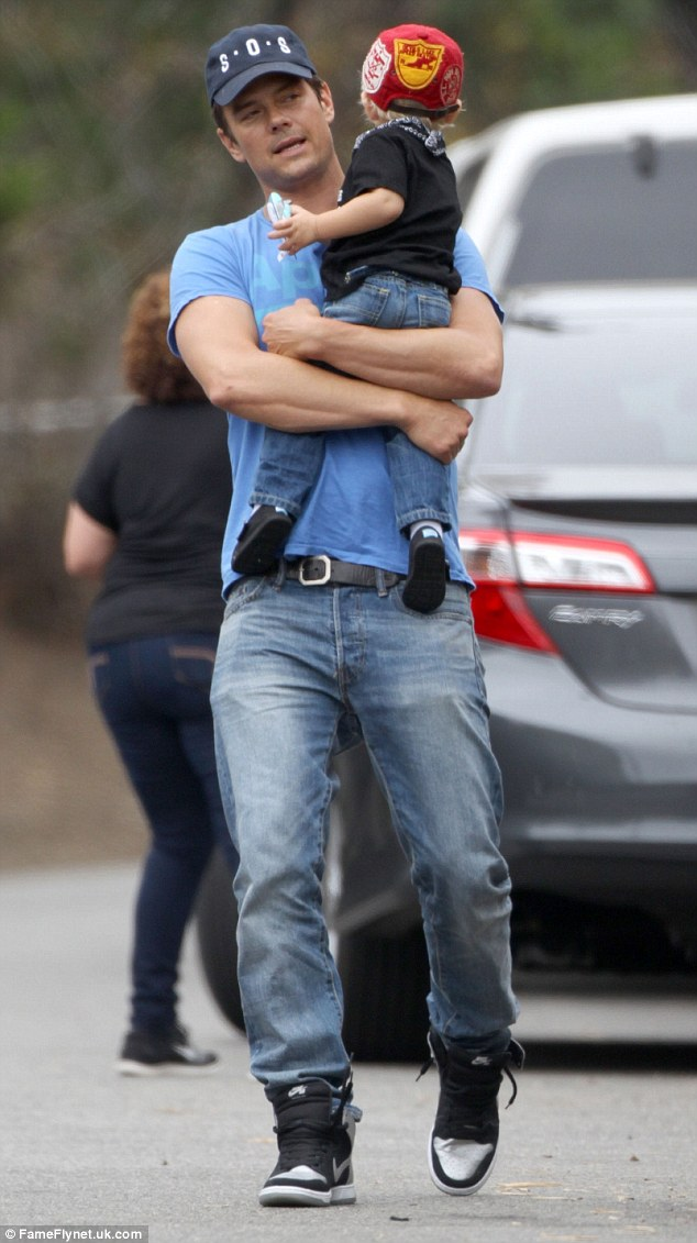 His little guy: Axl was clearly comfortable in his father's arms