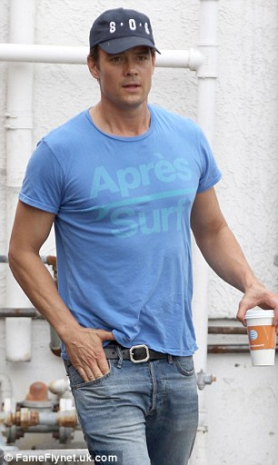 Pep in his step: The actor treated himself to a cup of coffee during his morning out