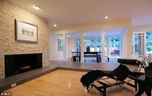 That's different: The large lounge room which features Californian rarity - not one but two fireplaces