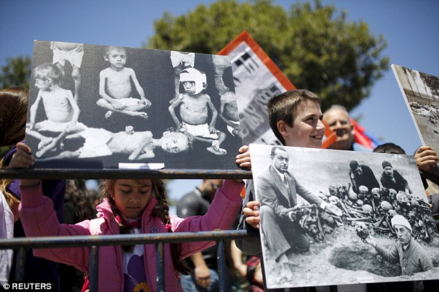 Children hold placards depicting the massacre of the Armenians   during a protest outside the Turkish consulate general in Jerusalem