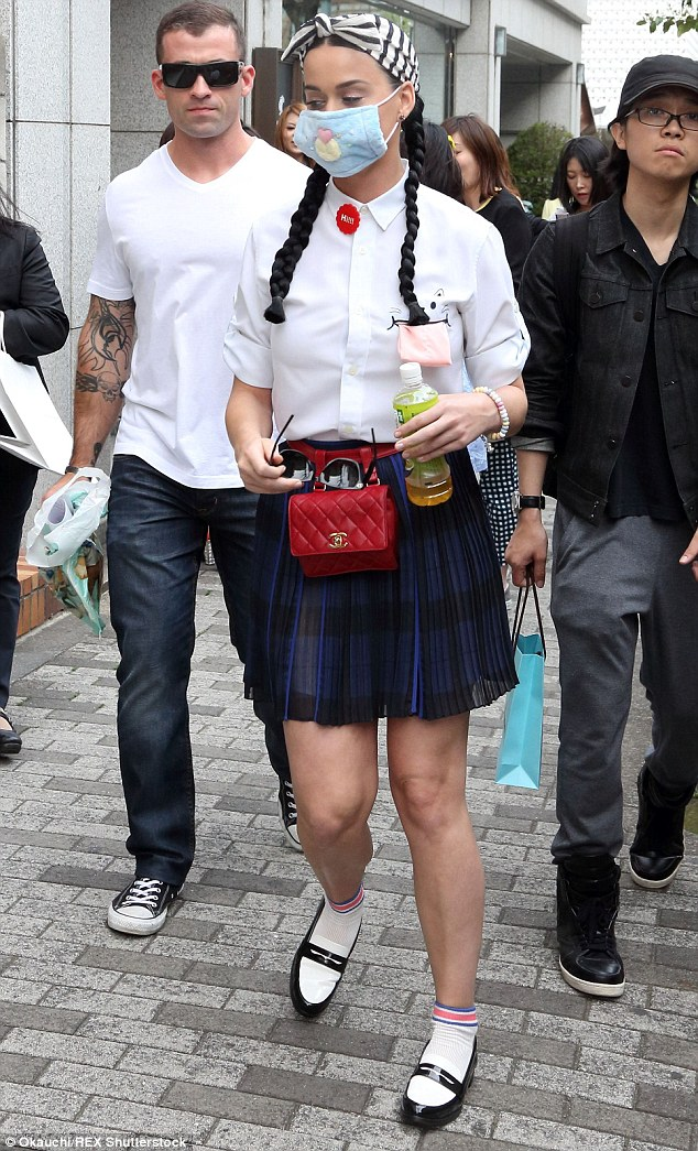 Harajuku Girl coming through! The 30-year-old put on a leggy display in a royal blue pleated skirt, which boasted a short hemline and a tight waistband, while teaming it with a crisp white shirt