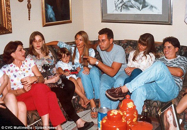 Knockout even before fame:One photo shows her gathered on a sofa with some of her family members. Already Sofia, who must have been in her early twenties at the time, was looking very sexy in a shirt that is not buttoned up all the way, fitted jeans and platform snake heels