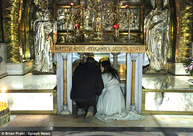 Privileged: The famous couple - who married in 2014 - woke up early to see the site of the crucifixion of Jesus Christ, and crouched below the altar in the holy temple