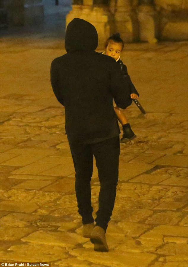 Adorable: Perhaps unaware of the baptism ceremony focused on her that had taken place hours before, North was taken on a tour around the Old City with daddy