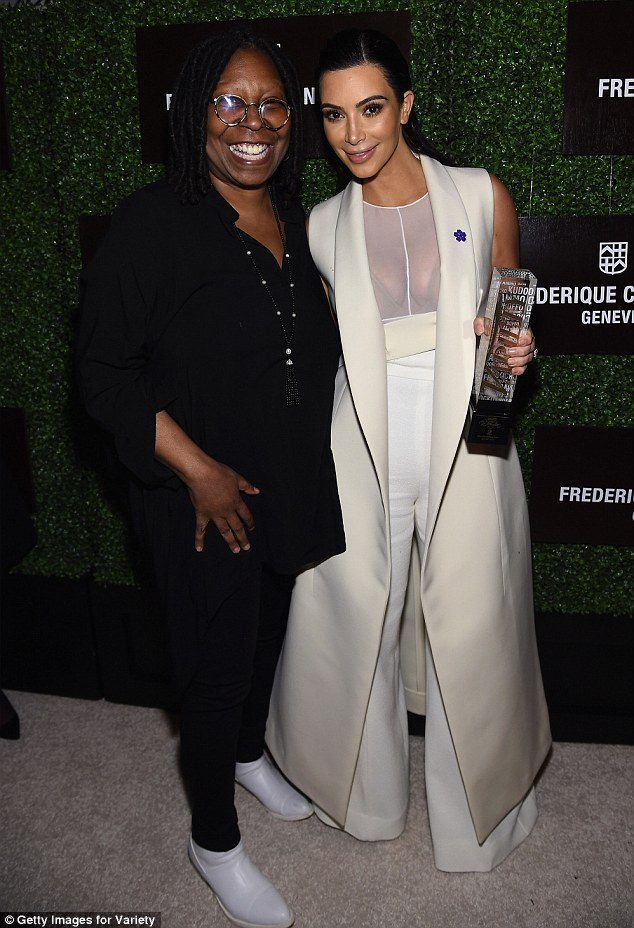 Celebrated: The mother-of-one took a photo with Whoopi Goldberg, who was also honoured, after she was given her trophy