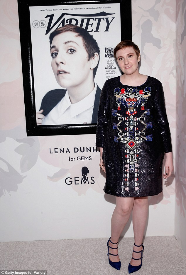 Proud: Lena, who also sported strappy blue heels, took a photo beside her version of the magazine cover as she was honoured for supporting GEMS