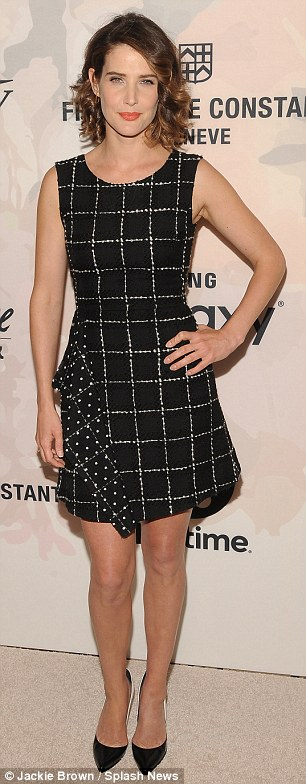 Checked: Cobie Smulders showed off her thin pins in a patterned black and white frock detailed with an asymmetrical ruffled accent