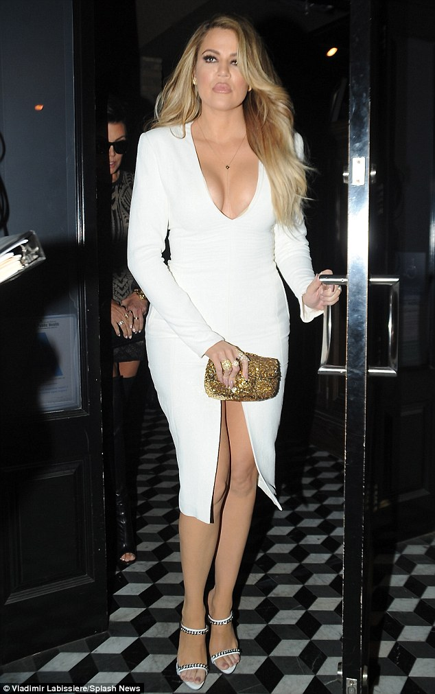 Spilling out: Khloe Kardashian showed off ample cleavage during a dinner date with her family at Craig's Restaurant in Los Angeles on Thursday