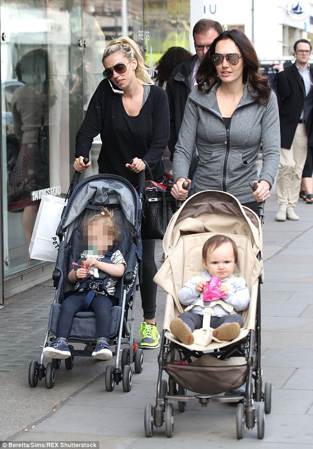 Shopping and mothering: The young women looked delighted as they stepped out with their daughters