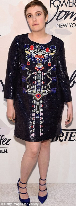 Shimmering: lena donned a sequined navy blue number featuring an intricate design on the front
