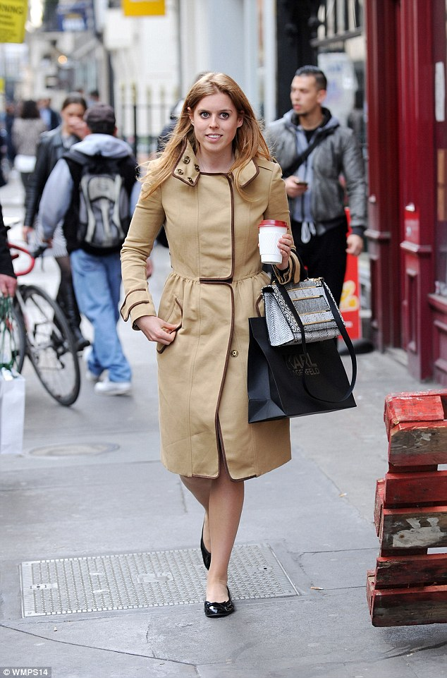 Simple: The princess wore a camel-coloured coat with brown piping, with black ballet pumps and carried a snakeskin print handbag for the upmarket shopping trip
