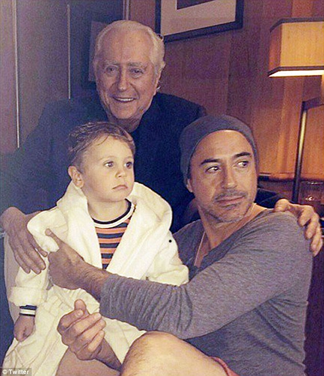 Boy's club: The Avengers actor has a three-year old son Exton, seen here with the toddler's grandfather Robert Downey Sr in January