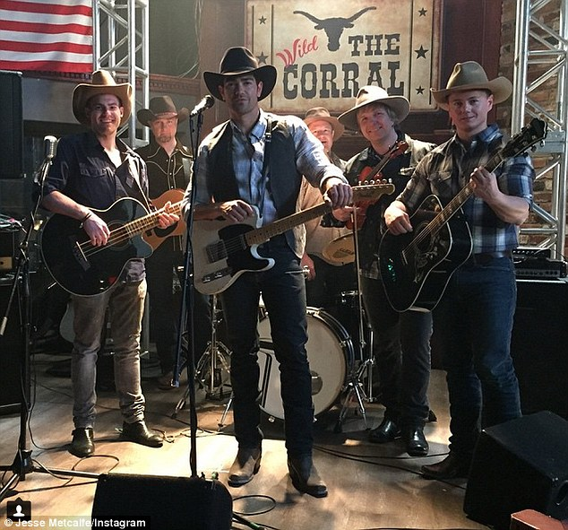 On guitar: Jesse, who plays a country music star, posted this snap on Instagram on Thursday, saying, 'Gettin' the band back together!!! Lol! Thanks to Jordan, Geoff, Mike, Jay and Joe for their support, musicianship and being part of one of the coolest moments I've had on set'