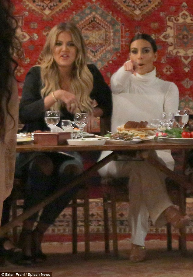 Learning the moves: Khloe Kardashian (left) and sister Kim Kardashian (right) attended a traditional Armenian feast with inside a converted carpet factory recently