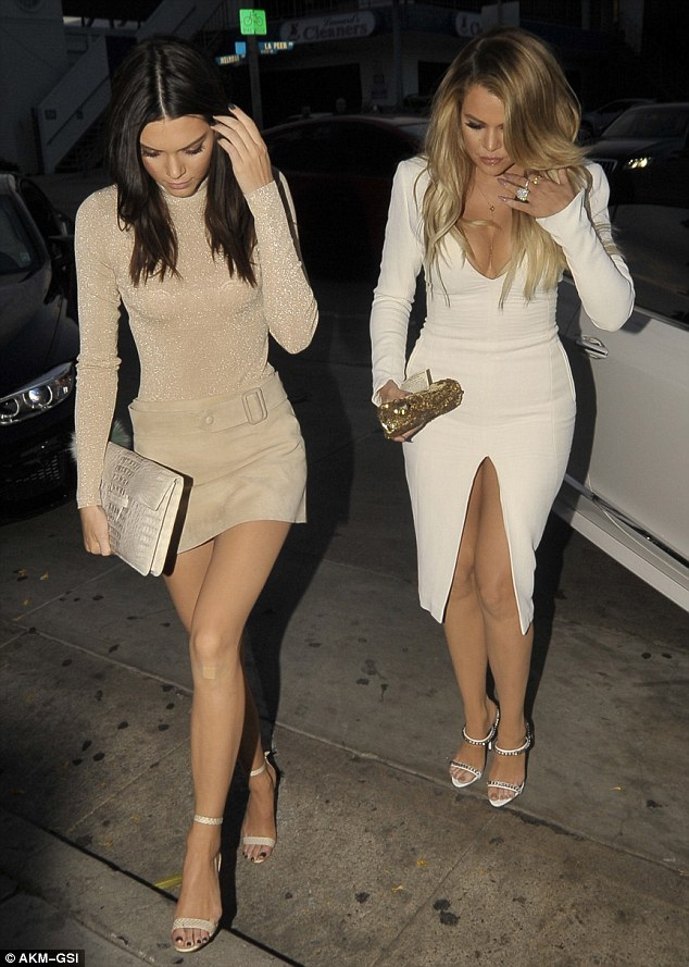 Klassy: The model of the moment donned a suede mini skirt that was accented with a matching belt around her thin torso while older sister Khloe Kardashian went all white