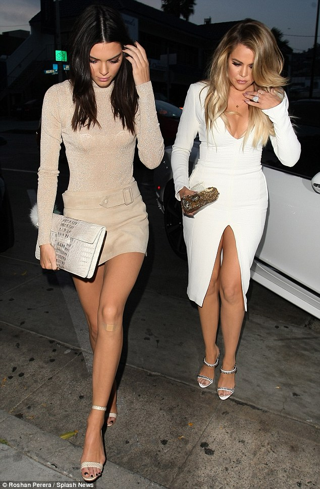 Long legs: The sisters showcased their lean legs in revealing frocks