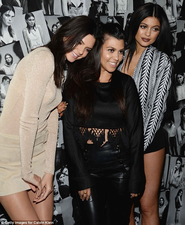 Mom's night out: Kourtney Kardashian was enjoying a rare night off from her parenting duties as she partied with sisters Kendall and Kylie
