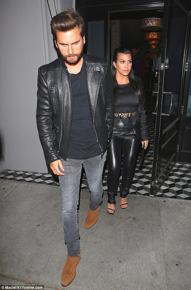 Hand-in-hand: Parents-of-three Scott Disick and Kourtney were affectionate en route back to their car