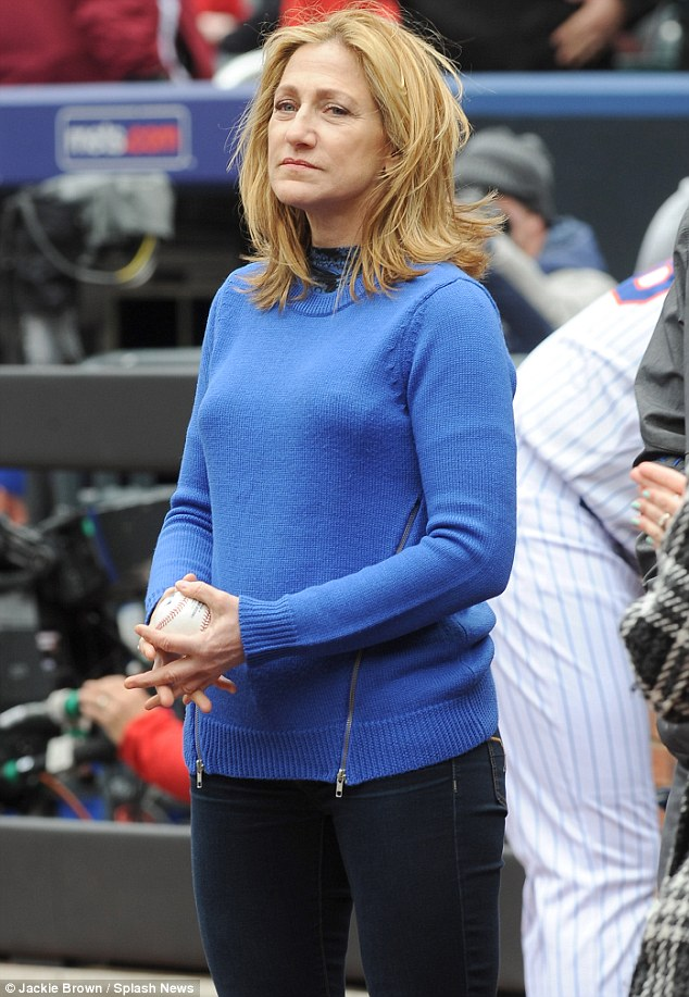 Taking it very seriously: The actress, dressed in her team's blue, took a moment to concentrate on her task