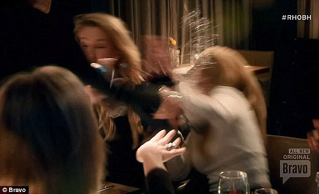 Drama: Lisa's explosion came after Kim refused to accept her apology for bringing up past issues with substance abuse as she is pictured throwing water in the face of her castmate
