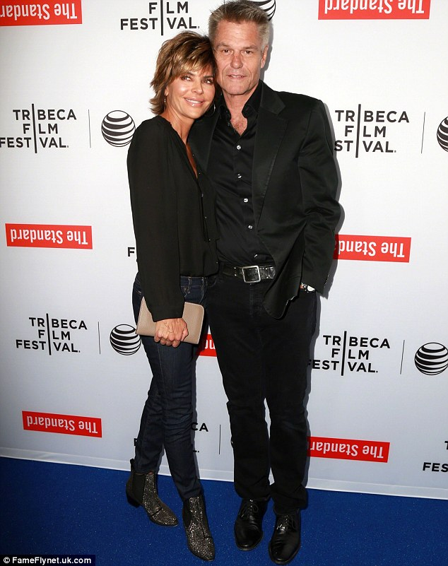 Standing by her man: At the centre of the dust-up was Lisa's relationship with her fellow actor husband Harry Hamlin as they were pictured together at the 2015 Tribeca Film Festival LA Kickoff Reception on March 24