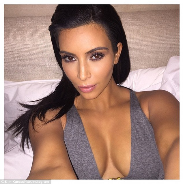 Immaculate confession: Kim, 34,  shared this selfie Thursday morning with the caption: 'last night right before I fell asleep with all of my make up on grrrrrr'