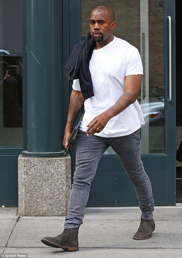 Places to be: Kanye West was also seen leaving the couple's Soho apartment on his way to meetings Thursday. The rapper kept to his usual casual style with a pair of skinny jeans, boots and a white t-shirt