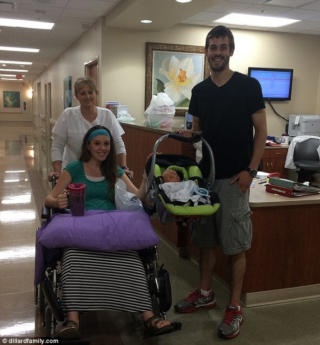 On the way home: Jill was escorted by a wheel chair with their newborn in his baby carriage