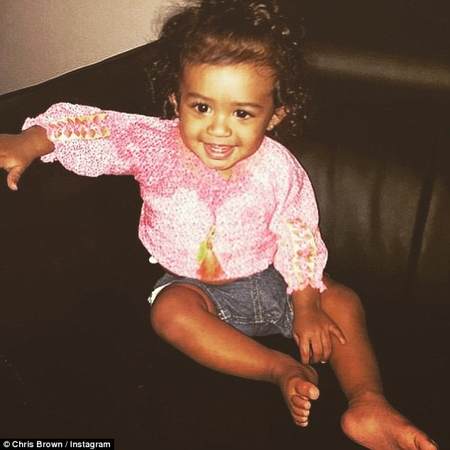 What a smiler: Chris has reportedly been trying to get Royalty's mother Nia Guzman to move closer to LA so he can be near to his daughter
