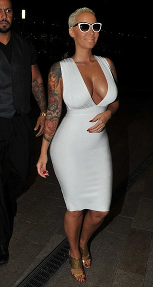 Bold move: The tight number flattered the star's ample curves perfectly as she made her way along the streets