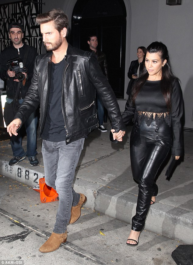 Leading the way: Scott Disick led his long-term partner Kourtney Kardashian out of Craig's Restaurant in Los Angeles on Thursday night after a family dinner