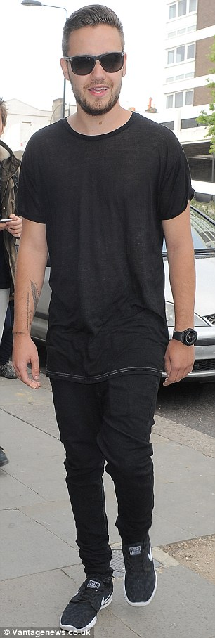 Working boys: Liam Payne was spotted heading to a London studio on Friday