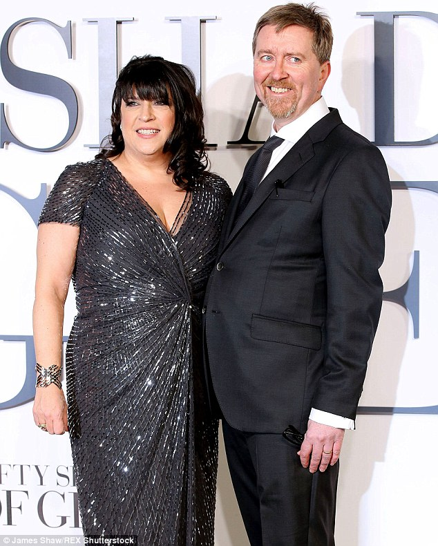 Teaming up: E.L. James and her husband Niall Leonard who will write the sequel Fifty Shades Darker are shown in February at the London premiere of Fifty Shades Of Grey