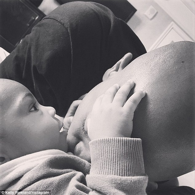 Proud mama: Kelly shared this sweet black and white photo of new son Titan and husband Tim to her Instagram this month