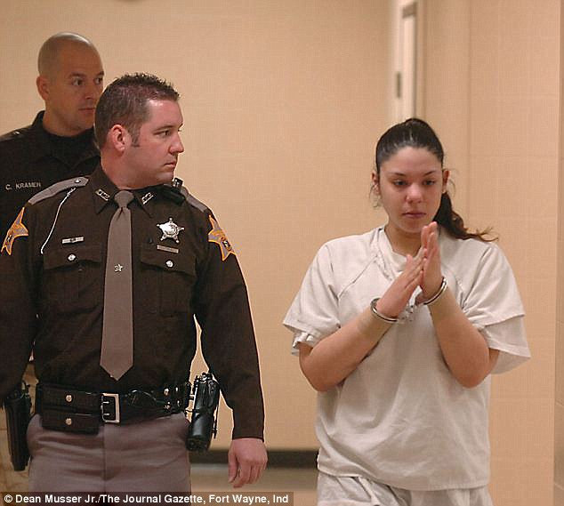 Court: Emily Castro, then 19, is pictured going to her initial hearing charged with attempted murder and felony battery for cutting her 10-month-old daughter's neck several times in 2008. She also accused Colon of rape