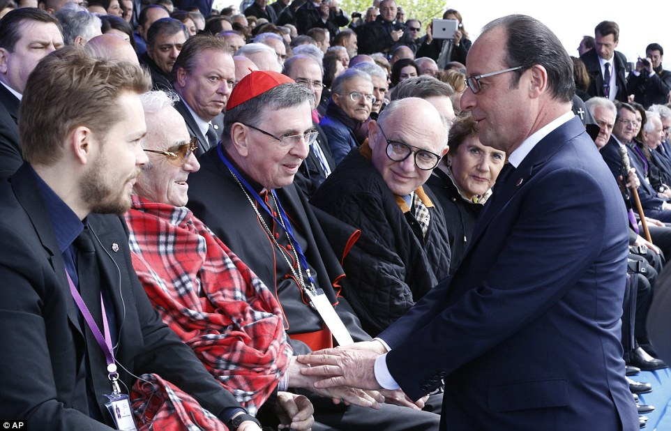 Hollande greets singer Charles Aznavour, second from left, during a memorial service at the Tsitsernakaberd Armenian Genocide memorial