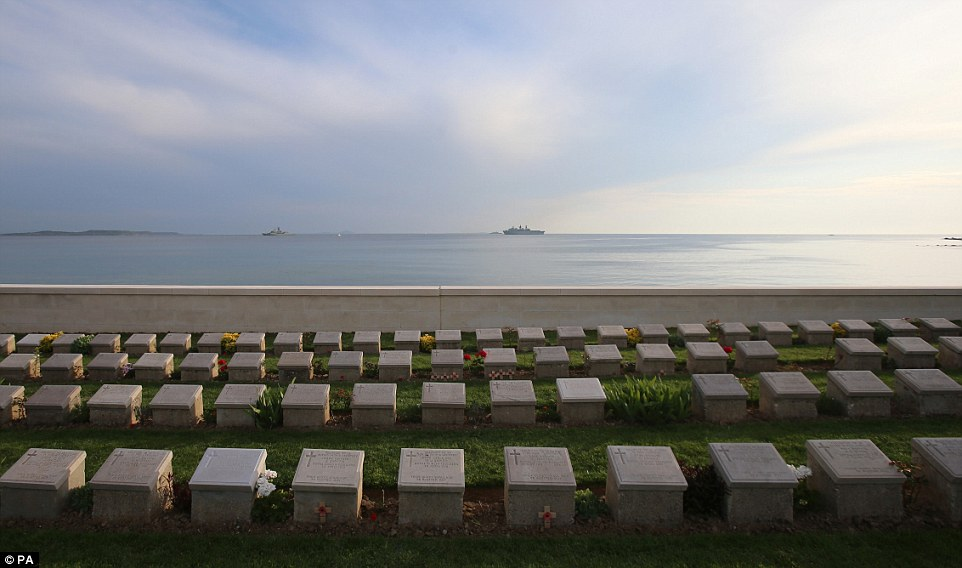 Several boats stand silently where 100 years ago, thousands of soldiers were killed as they tried to get a foothold on the beach