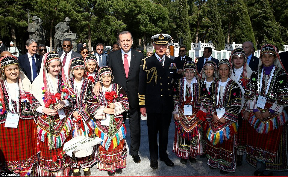 President of Turkey Recep Tayyip Erdogan and Prince Charles pose for a photo with children after today's commemoration ceremony
