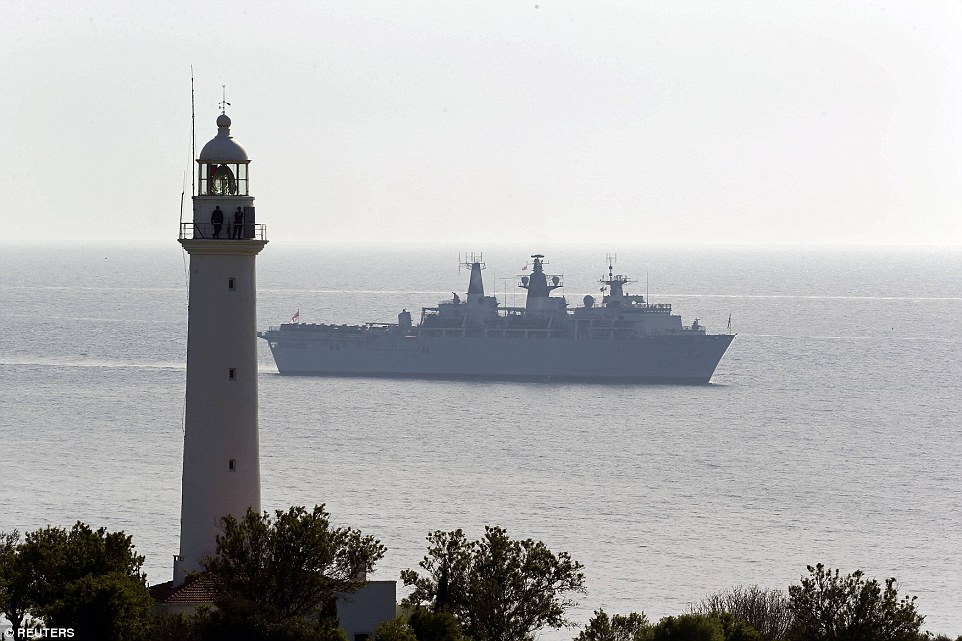 Royal Navy flagship, the HMS Bulwark, is seen in the Dardanelles straits near Gallipoli today. HMS Bulwark, also with three helicopters and two other border patrol ships, will be part of the operations to help the migrant crisis in the Mediterranean once it leaves the area