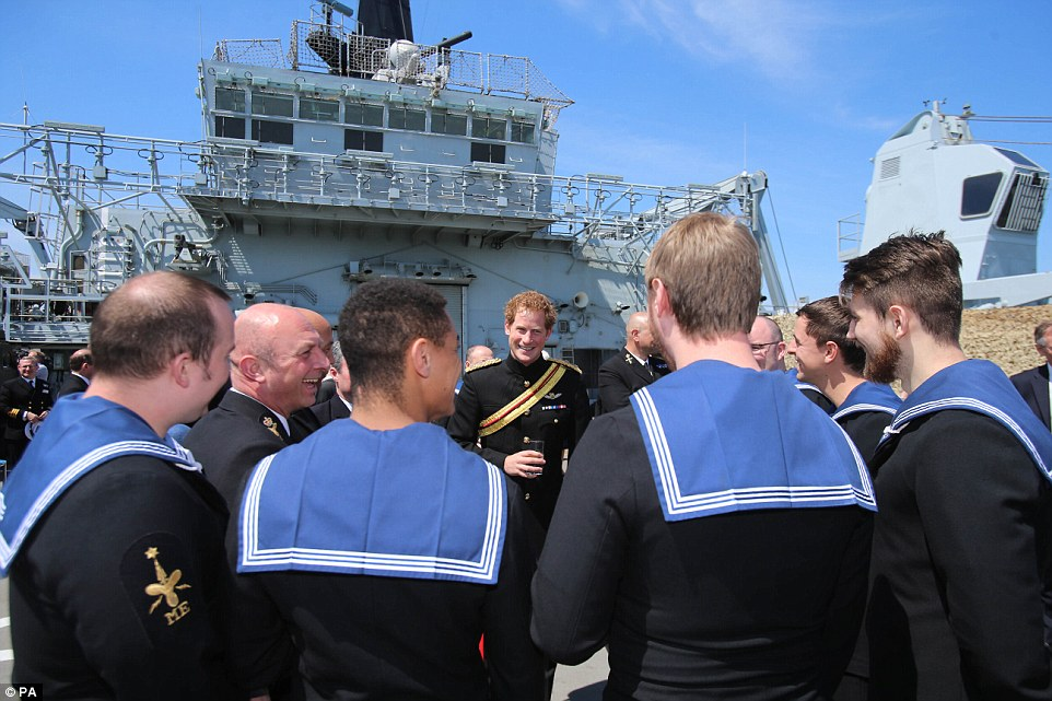 Prince Harry meets crew members as he attends a reception on HMS Bulwark with relatives of veterans of the World War One Gallipoli landings