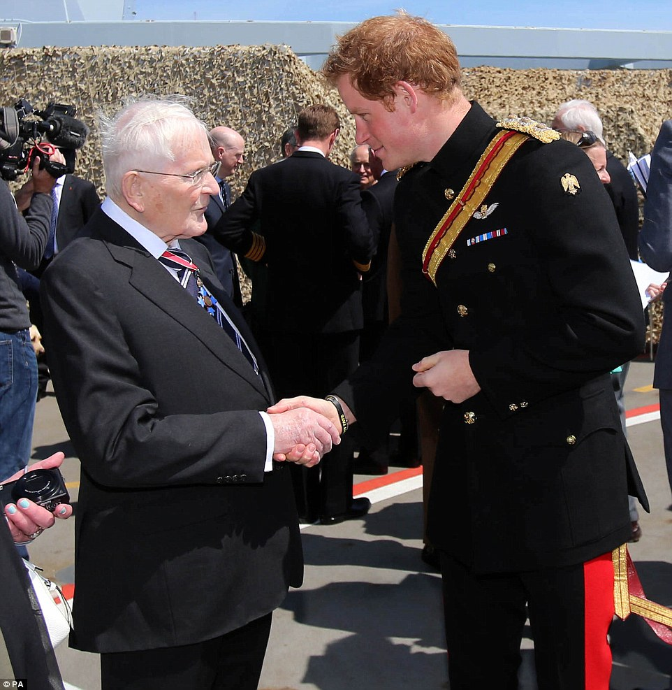 Meet and greet: Prince Harry chats with Roger Boissier, the son of a Gallipoli veteran during a reception on HMS Bulwark