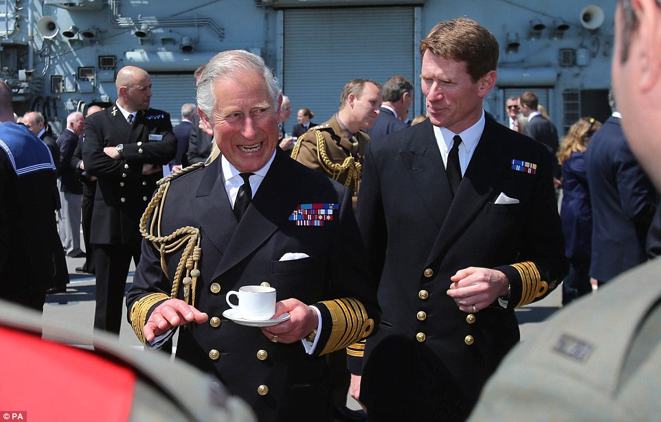 The Prince of Wales enjoys a cup of tea with Captain Nick Cooke-Priest during a reception on HMS Bulwark  in Turkey's Dardanelles straits
