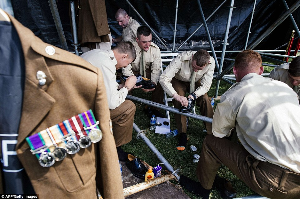 Spit and polish: British soldiers put on the finishing touches to their uniforms at at the Helles Memorial prior to the memorial service