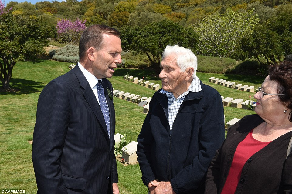 Australian Prime Minister Tony Abbott chats with Ron Eyres whose father Private Samuel Eyres was injured at Shrapnel Valley during the war