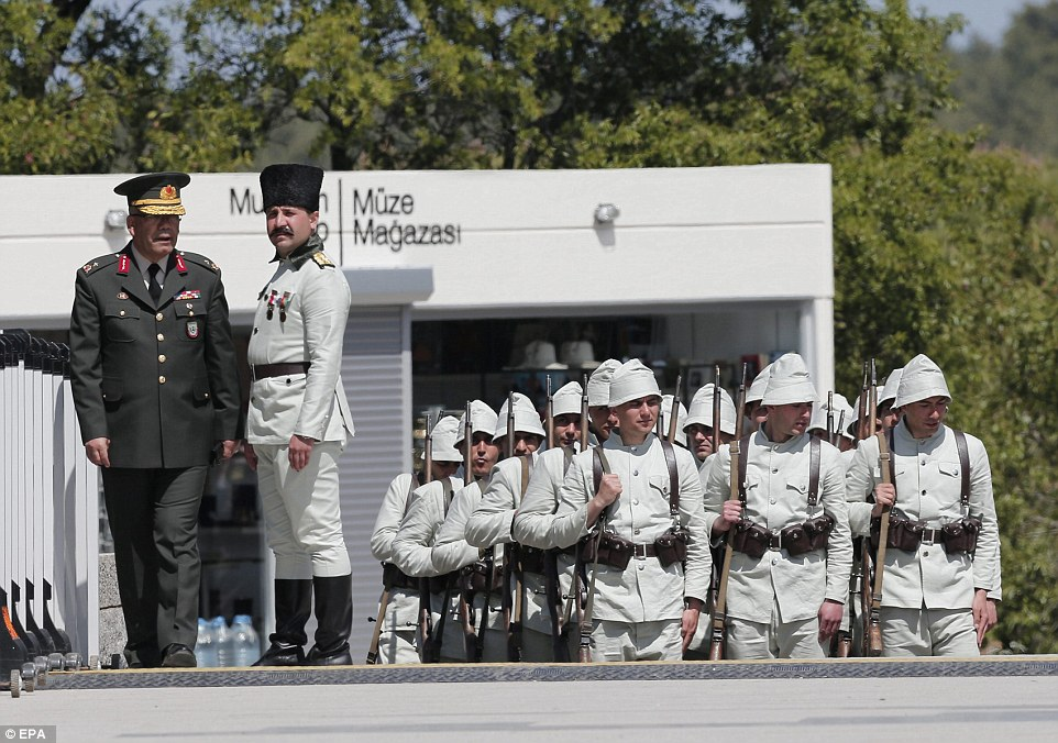 Turkish soldiers wait  before the commemoration of the Battle of Gallipoli in front of the Turkish Mehmetcik Monument in Gallipoli